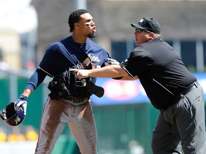 Milwaukee Brewers' Carlos Gomez yells at Pittsburgh Pirates starter Gerritt Cole. Gomez is being separated by homeplate umpire Fieldin Culbreth.