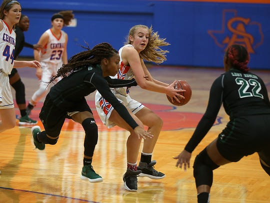 Central's Parris Parmer is surrounded by Killeen Ellison