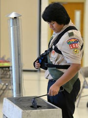 Eagle Scout candidate James Boyle, 16, shows an example of a stove he is raising money to send to families in Guatemala. Boyle held a fundraising luncheon as part of his Eagle Scout project Sunday, Nov. 15 at St. Peter's Catholic Church in St. Cloud to raise the money for stoves to be sent to Guatemala.