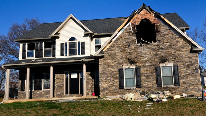 Fire damaged a house at 2312 Bodie Island Drive, Greene Township, Monday, Nov. 23, 2015. Firefighters arrived just after midnight to find fire through the roof.