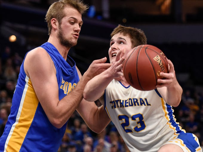 St. Cloud Cathedral's Michael Schaefer tries to get