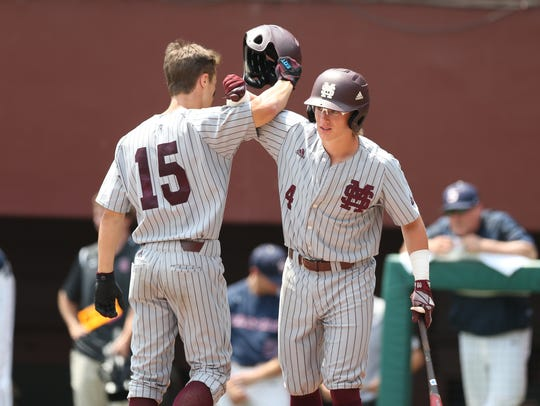 Mississippi State hitter Rowdy Jordan (4) congratulates