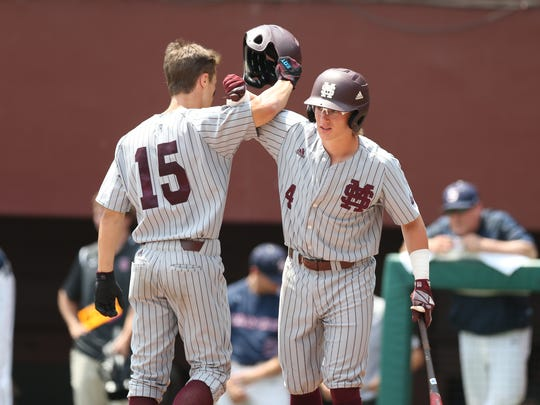 Mississippi State hitter Rowdy Jordan (4) congratulates his teammate Jake Mangum (15) following Mangum's home run Sunday in Tallahassee, Fla.