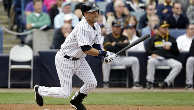 Yankees shortstop Derek Jeter bats during an exhibition game against the Pittsburgh Pirates on Thursday in Tampa, Fla.