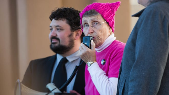Jan Thompson, center, the president of the LAs Cruces Coalition for Reproductive Justice, spoke to the crowd of over a thousand people gathered in the Plaza de Las Cruces, Saturday, January 21, 2017, to protest for women's rights among other concerns with the new Trump administration.