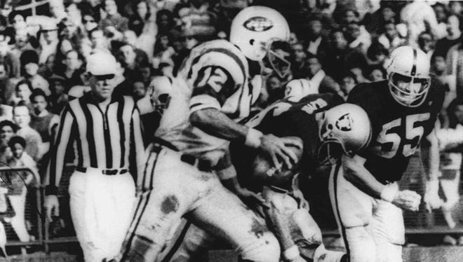 "New York Jets quarterback Joe Namath sweeps around the right side to score from the 1-yard line during the second quarter against the Oakland Raiders in this Nov. 17, 1968, file photo. The Jets led 32-29 with just less than a minute left when NBC went to a commercial and switched to the movie ""Heidi.'' The Raiders then scored two touchdowns to win the game."