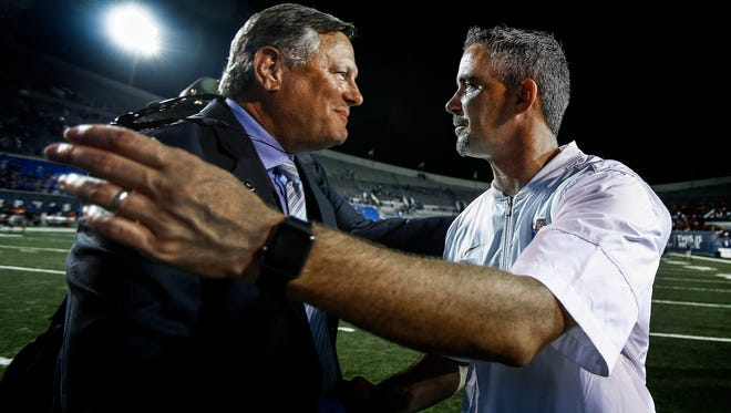 Memphis athletic director Tom Bowen (left) congratulates coach Mike Norvell (right) after his first victory with the Tigers -- a 35-17 win over Southeast Missouri State on Sept. 3, 2016, at Liberty Bowl Memorial Stadium.