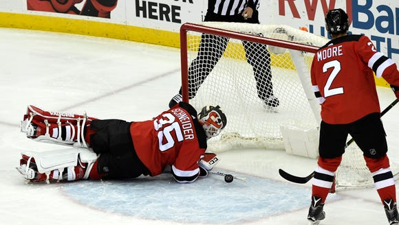 New Jersey Devils goaltender Cory Schneider (35) watches