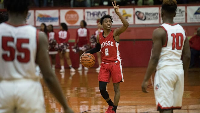 Bosse's Mekhi Lairy (2) calls out a play against Harrison at Harrison High School on Tuesday, Feb. 13, 2018. Bosse defeated Harrison 71-63.