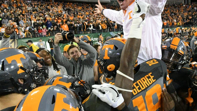 Tennessee Volunteers head coach Butch Jones celebrates with his team at the end of the Franklin American Mortgage Music City Bowl at Nissan Stadium in Nashville, Tenn., Friday, Dec. 30, 2016. Tennessee won 38-24.
