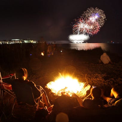 People watch the Fourth of July fireworks near small