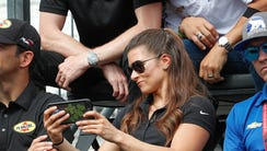 Danica Patrick takes a selfie with Ton Kanaan and Scott