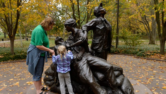 Sara Orndorff and Morganne Miller, 5, visit the Vietnam Women's Memorial Nov. 7.  This year's Veterans Day observance will celebrate the 20th anniversary of the monument.