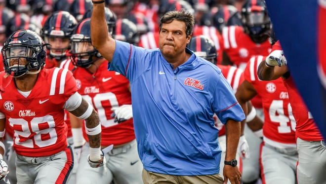 Mississippi head coach Matt Luke leads the team onto the field for the game against South Alabama at Vaught-Hemingway Stadium in Oxford, Miss. on Saturday, Sept. 2, 2017. (Bruce Newman/The Oxford Eagle via AP)
