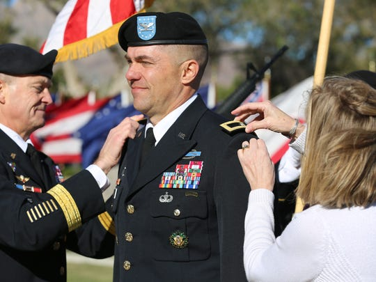 Gen. Daniel B. Allyn, left, the vice chief of staff of the Army, and Morri Landes, wife of Brig. Gen. Mark H. Landes, attach Landes' new rank during his promotion ceremony on Nov. 18.