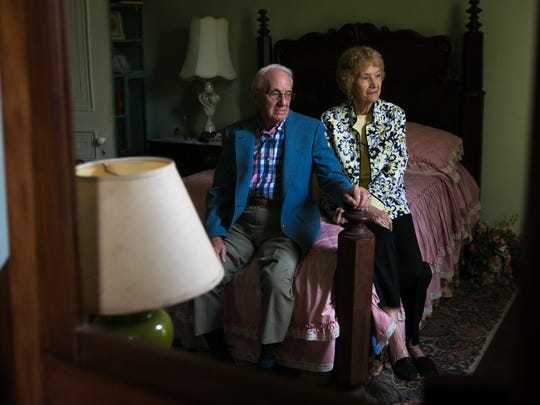 "Helen and George Sipala sit on the bed that Andrew Wyeth painted them on at their house ""Painter's Folly"" in Chadds Ford."