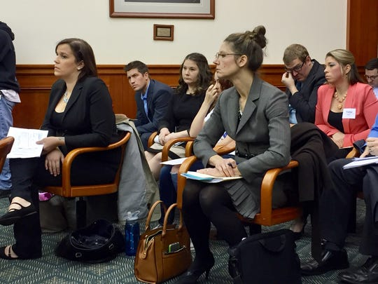 Erica Hammel, 28, of St. Clair Shores (front row), waits for her turn to speak in support of Wyatt's Law during a hearing at of the state House of Representatives committee on Family, Children, and Seniors on Wednesday, Nov. 30, 2016. Every seat in the room was full.