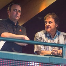 Diamondbacks President and CEO Derrick Hall and Chief Baseball Operator Tony La Russa watch their team play against the Dodgers at Chase Field in Phoenix on May 18, 2014.