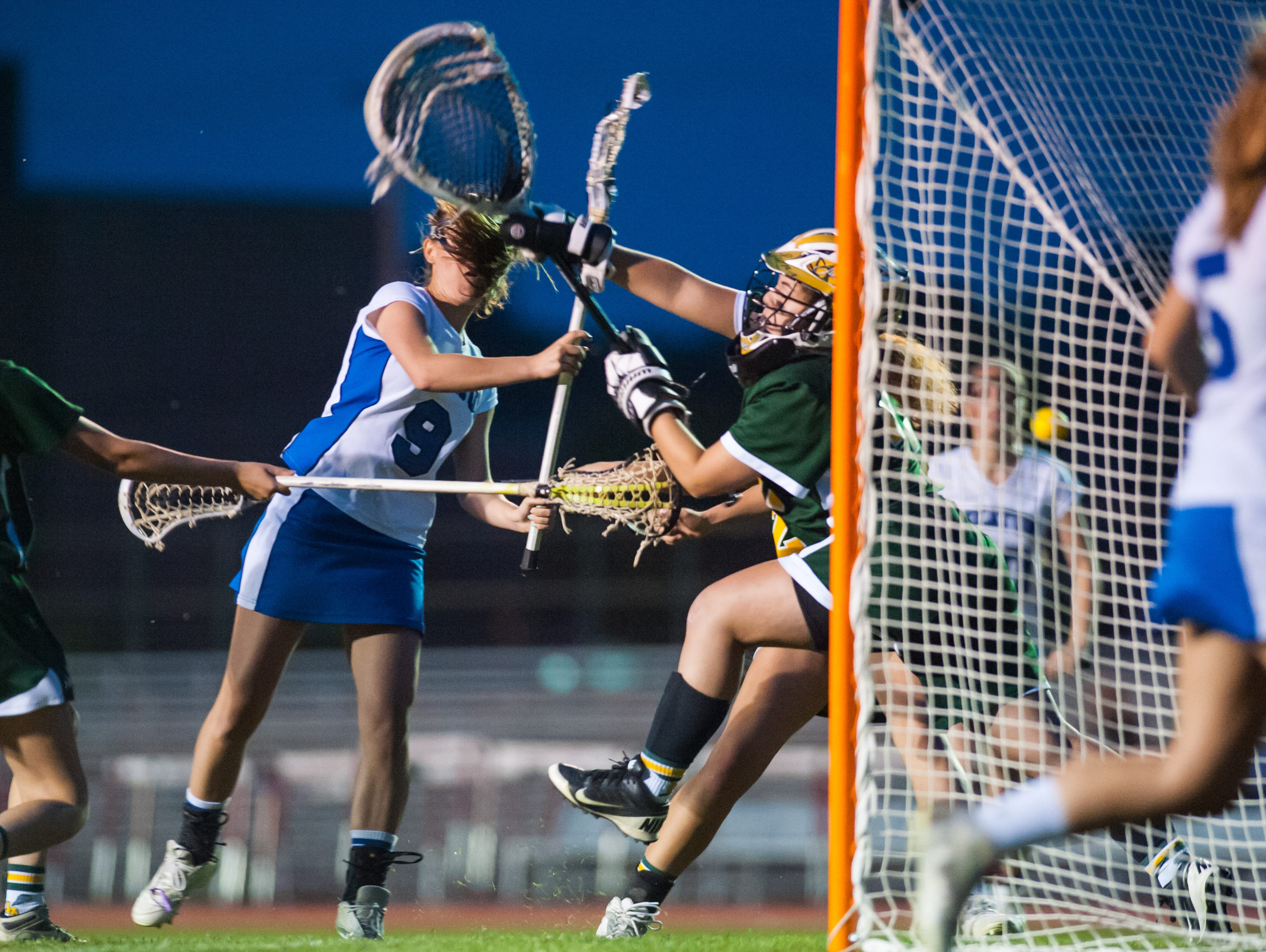 Stephen Decatur attack Blair Yesko (9) takes a shot against Queen Annes' on Tuesday evening at Wicomico County Stadium in the Bayside Girls Lacrosse Championship.