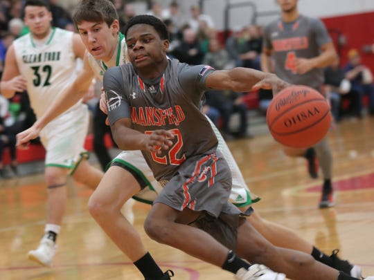 Mansfield Senior's Angelo Grose drives to the basket during Friday's Division II sectional championship game with Clear Fork.
