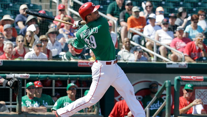 The Cincinnati Reds' Devin Mesoraco hits a two-run home run during the first inning of a spring training baseball game against the Cleveland Indians on Thursday, March 17, 2016, in Goodyear, Ariz.