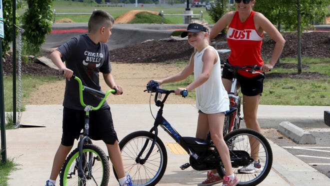 Jessica Wilson joins her children, Jackson, 11, and Jaycee, 7, Monday, June 1, 2020, for a five-mile ride on the Greg Smith River Trail along the Arkansas in downtown Fort Smith.