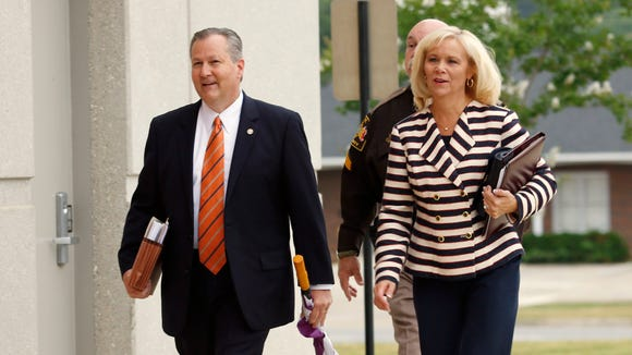 Mike Hubbard and Susan Hubbard walk to the Lee County Justice Center for Mike Hubbard's trial on Monday, June 6, 2016  in Opelika, Ala. Hubbard faces 23 felony ethics charges accusing him of using his political positions to make money and seek financial favors, investments and employment from lobbyists and people with business before the Alabama Legislature.  (Todd J. Van Emst/Opelika-Auburn News via AP, Pool)
