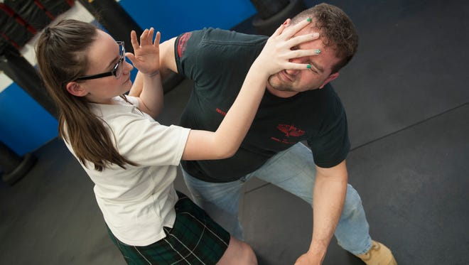 Kierstyn Carter, 14 of Haddonfield, demonstrates a self-defense technique used when defending against a wrist pull, with Don Melnick, owner/instructor of Israeli Krav Maga in Cherry Hill on April 18, 2018.