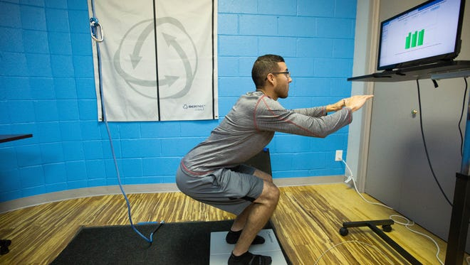 Mark Tovar, a physical therapy technian deomstrates the Bertec System at Southwest Sport and Spine Center. Jna 4, 2018. The Bertec system helps diagnose problems in how a person stands and how it can affect their stability and recovery from balance issues.