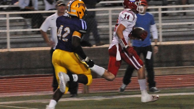 Evangel's Tanner Ash scores a first-quarter touchdown against Byrd.