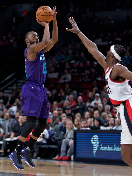 Charlotte Hornets guard Kemba Walker, left, shoots over Portland Trail Blazers forward Noah Vonleh during the first half of an NBA basketball game in Portland, Ore., Tuesday, Jan. 31, 2017. (AP Photo/Craig Mitchelldyer)
