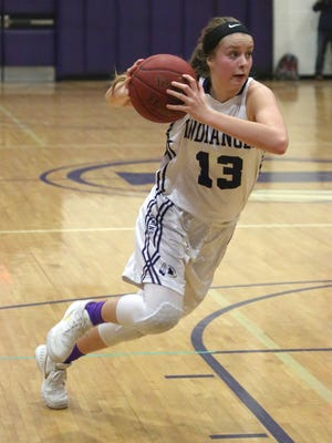 Indianola freshman Maggie McGraw cuts toward the basket against West Des Moines Valley. The Indians won at home in a Class 5-A regional final Feb. 23 to advance to the state tournament.