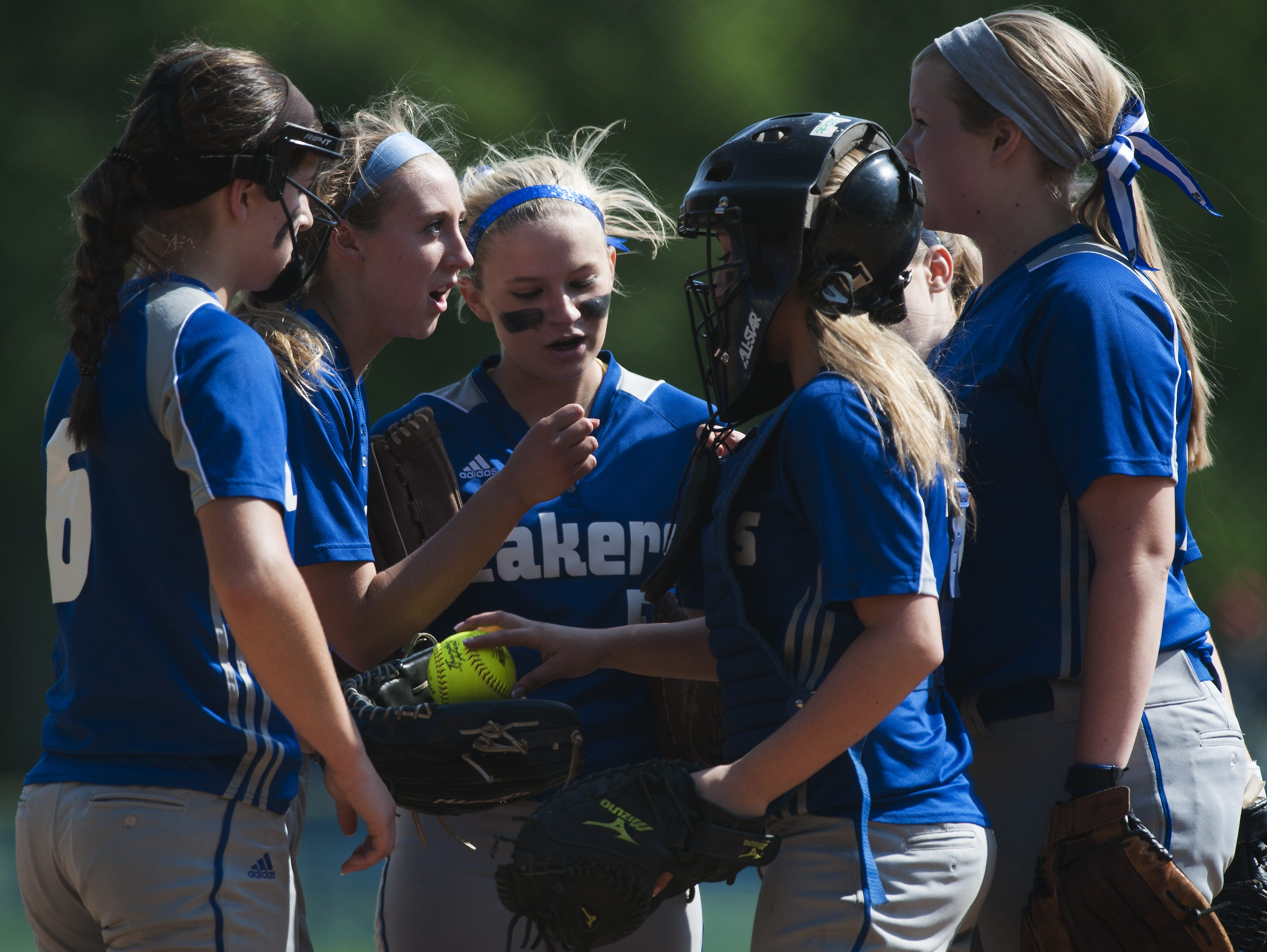 The Colchester infield huddles together before the start of an inning during the girls softball playoff game between the Mount Mansfield Cougars and the Colchester Lakers at Colchester High School on Friday afternoon June 5, 2015 in Colchester.
