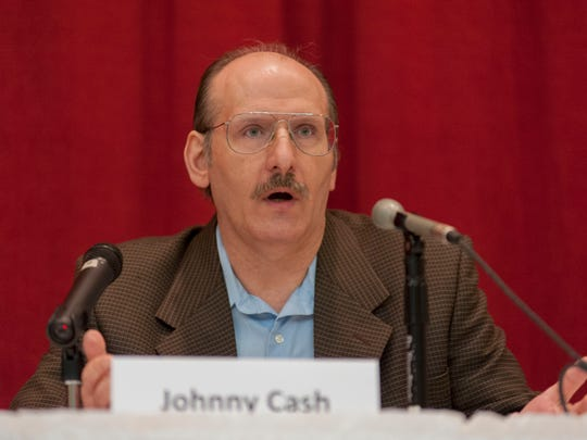 Johnny Cash speaks in 2013 as a Battle Creek City Commission candidate during a public forum.