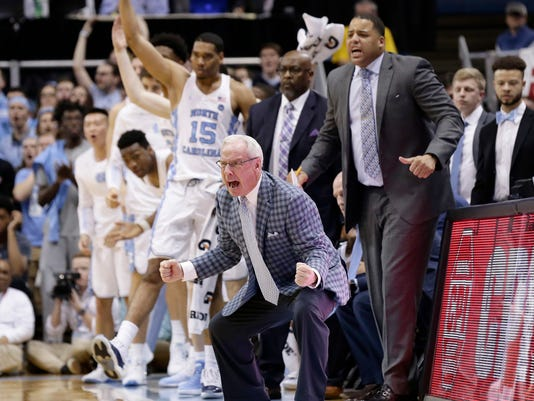 North Carolina coach Roy Williams, front center, yells late in the second half of an NCAA college basketball game against Duke in Chapel Hill, N.C., Thursday, Feb. 8, 2018. (AP Photo/Gerry Broome)
