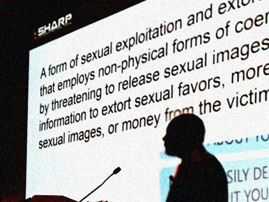 "Special Agent Gabriel Henson, with NCIS, defined ""sextortion"" as a form of sexual exploitation and extortion that uses non-physical forms of coercion, Sept. 29, during the SHARP Program Improvement Forum, in Alexandria, Va. (Photo Credit: U.S. Army)"