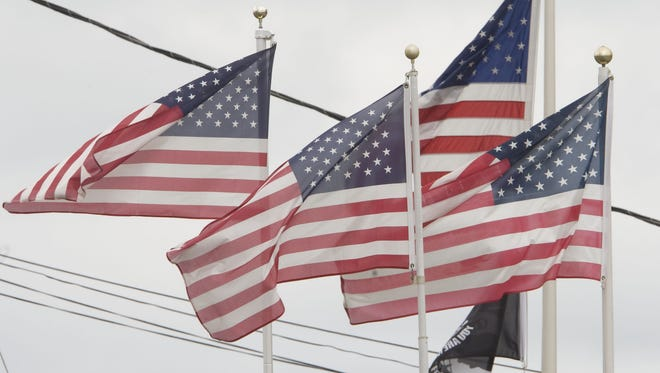 Flag Day feature. Kempton Flag Co. on Rt 35 in Wall flies multiple flags in front of its store .....Bob Bielk/Asbury Park Press-6/14/11-News-Wall