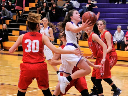 Wylie's Mary Lovelace drives the lane during Tuesday's