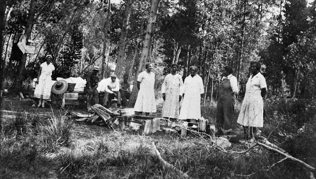 Octavia Bridgewater is standing on the far right in this 1926 photo, probably taken in Colorado Gulch near Helena.