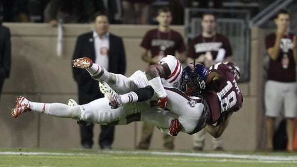 Ole Miss defensive back Tony Conner makes one of his 11 tackles during the win against Texas A&M on Saturday.