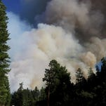 Smoke rises from the Cable Crossing Fire near Glide.