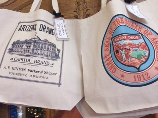 Tote bags bearing images from the state archives