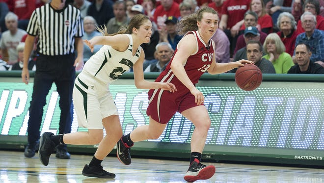CVU's Marlee Gunn (13) dribbles the ball down the court past St. Johnsbury's Neva Bostic (23) during the division I girls basketball championship between the Champlain Valley Union Redhawks and the St. Johnsbury Hilltoppers at Patrick Gym on Saturday afternoon March 18, 2017 in Burlington.