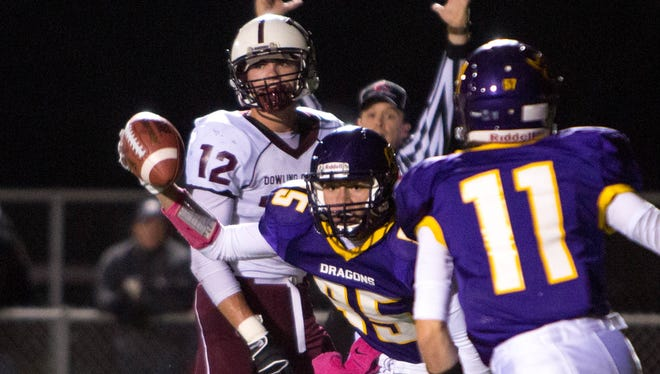 Johnston High School's Jacob Newcomb (85) celebrates a touchdown with Mark Johnson (11) in the second quarter Friday, Oct. 10, 2014, at Johnston High School.