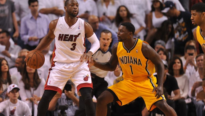 Heat shooting guard Dwyane Wade is defended by Pacers shooting guard Lance Stephenson.