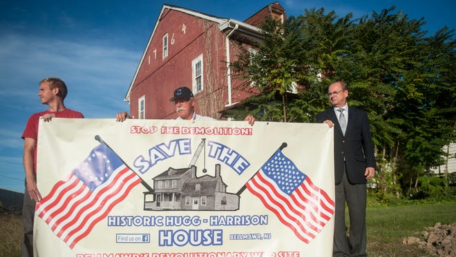 (From left) Camden County Historical Society member Adin Mickle, Rev. Vincent Kovlak of Bellmawr Baptist Church, and Camden County Historical Society President Chris Perks support the effort to save the historic Hugg-Harrison House in Bellmawr.