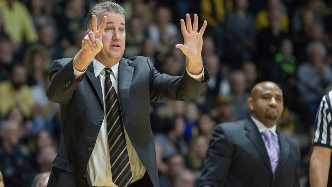 Purdue Boilermakers head coach Matt Painter calls out plays from the sideline with associate head coach Jack Owens at right in the first half of the game against the Penn State Nittany Lions at Mackey Arena on Jan. 21.