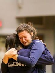 West York's Tesia Thomas, left consoles her teammate