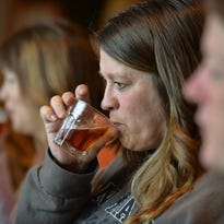 Tammy Jenson, center, Duelm, tries a sip of beer during the Women + Beer event at the Ace Bar and Grill in St. Cloud. The restaurant is also now hosting a multiple stop brewery tour.