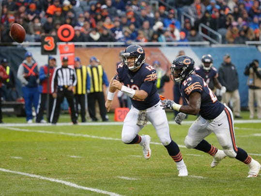 Chicago Bears quarterback Matt Barkley (12) and running back Jordan Howard (24) chase the loose ball during the second half of an NFL football game against the Tennessee Titans, Sunday, Nov. 27, 2016, in Chicago. (AP Photo/Charles Rex Arbogast)